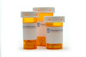 Three prescription drug bottles that can lead to prescription drug abuse.