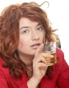 stressed out woman drinking