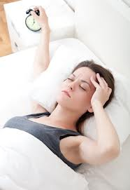 Woman wakes from restless sleep because of alcohol